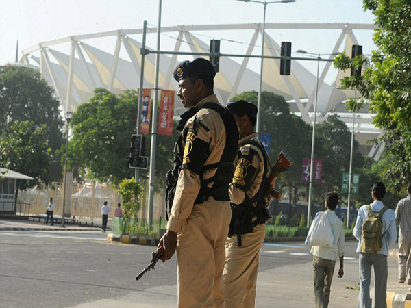 Indian security personnel stand guard beside the Jawaharlal Nehru Stadium, the main Commonwealth Games venue, following a traffic diversion in New Delhi on September 28, 2010.  The Indian capital is scheduled to host the Commonwealth Games on October 3-14, the biggest sporting event in the city since the 1982 Asian Games.   AFP PHOTO/Deshakalyan CHOWDHURY (Photo credit should read DESHAKALYAN CHOWDHURY/AFP/Getty Images)