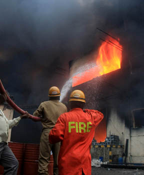 Firemen struggle for hours together to control the fire during a fire accident in Peenya in Bangalore on Friday. –KPN