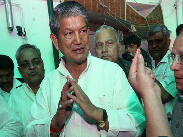 NEW DELHI, INDIA - MARCH 13: Congress leader Harish Rawat with his supporters at his residence in New Delhi on Wednesday. Rawat has been denied the post of Uttarakhand Chief Minister by party high command. (Photo by Kaushik Roy/India Today Group/Getty Images)