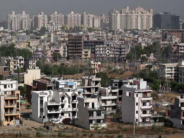 A general view of the residential apartments is pictured at Gurgaon, on the outskirts of New Delhi June 19, 2012. Welcome to Gurgaon, a city of wealthy urban professionals with gleaming shopping malls, five-star hotels and sprawling golf courses on the southern outskirts of New Delhi that is a symbol of newly affluent India. But crippling power and water shortages, crater-riddled roads and open sewage drains have made it an extreme example of the poor infrastructure that is constraining growth in Asia's third-largest economy. To match feature INDIA-INFRASTRUCTURE/GURGAON REUTERS/Parivartan Sharma (INDIA - Tags: BUSINESS CONSTRUCTION SOCIETY) - RTR34MVC